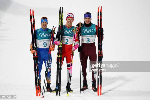 Silver medalist Federico Pellegrino gold medalist Johannes Hoesflot Klaebo of Norway and Alexander Bolshunov of Olympic Athlete from Russia celebrate...