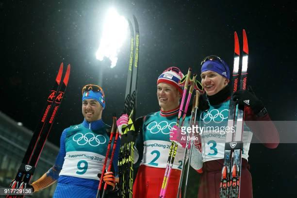 Silver medalist Federico Pellegrino, gold medalist Johannes Hoesflot Klaebo of Norway and Alexander Bolshunov of Olympic Athlete from Russia...