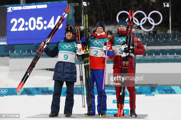 Silver medalist Federico Pellegrino gold medalist Johannes Hoesflot Klaebo of Norway and bronze medalist Alexander Bolshunov of Olympic Athlete from...