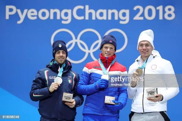 Silver medalist Federico Pellegrino gold medalist Johannes Hoesflot Klaebo of Norway and bronze medalist Alexander Bolshunov of Olympic Athlete from...