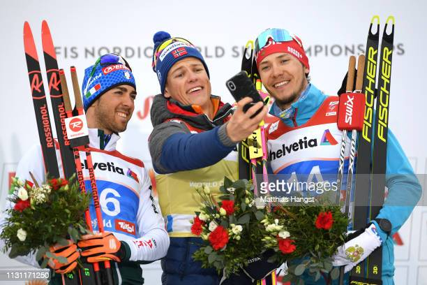 Silver medalist Federico Pellegrino of Italy Gold medalist Johannes Hoesflot Klaebo of Norway and bronze medalist Gleb Retivykh of Russia take a...