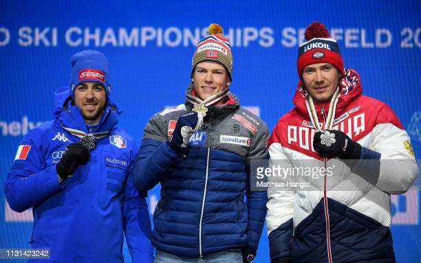 Silver medalist Federico Pellegrino of Italy Gold medalist Johannes Hoesflot Klaebo of Norway and Bronze medalist Gleb Retivykh of Russia pose with...