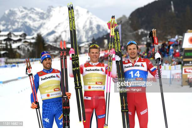 Silver medalist Federico Pellegrino of Italy Johannes Hoesflot Klaebo of Norway and bronze medalist Gleb Retivykh of Russia celebrate during the...