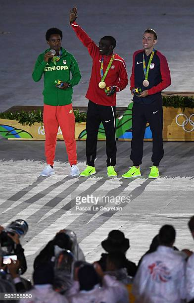 Silver medalist Feyisa Lilesa of Ethiopia gold medalist Eliud Kipchoge of Kenya and bronze medalist Galen Rupp of the United States celebrate afteron...