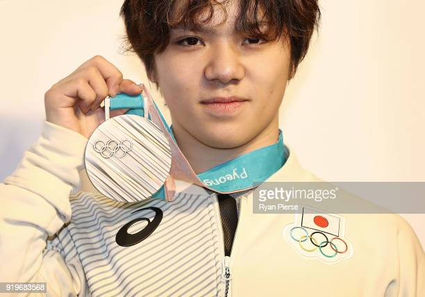 Silver Medalist Figure Skater Shoma Uno of Japan poses with his medal during a press conference at Japan House on February 18, 2018 in...