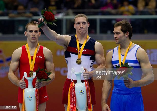 Silver medalist Flavlus Koczi of Romania gold medalist Steven Legendre of the USA and bronze medalist Alexander Shatilov of Israel stand on the...
