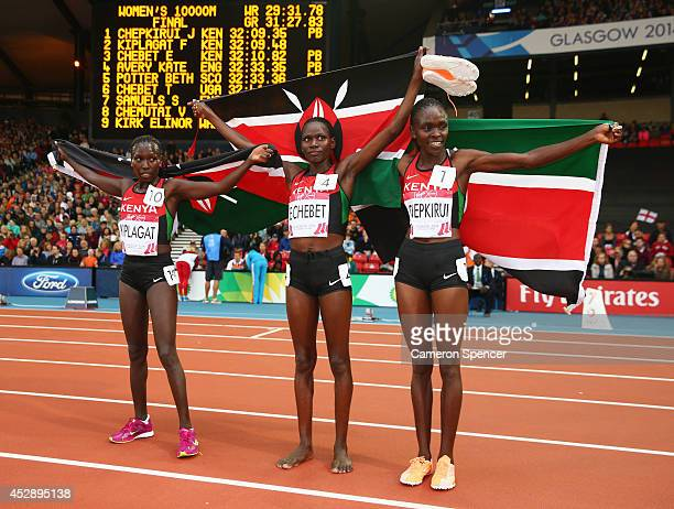 Silver medalist Florence Kiplagat of Kenya Bronze medalist Emily Chebet of Kenya and Gold medalist Joyce Chepkirui of Kenya pose after the Women's...
