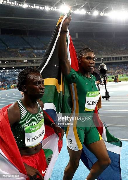 Silver medalist Francine Niyonsaba of Burundi and gold medalist Caster Semenya of South Africa celebrate after the Women's 800 meter on Day 15 of the...