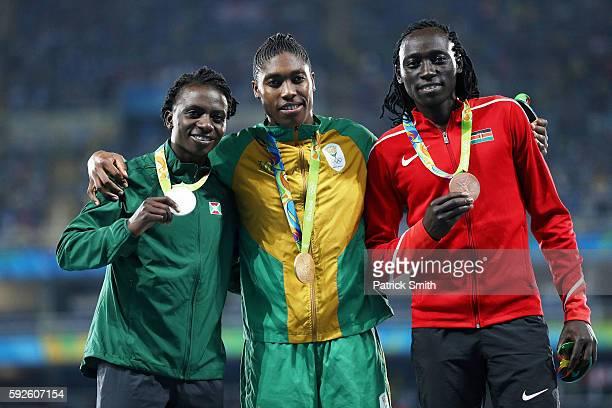 Silver medalist Francine Niyonsaba of Burundi gold medalist Caster Semenya of South Africa and bronze medalist Margaret Nyairera Wambui of Kenya...