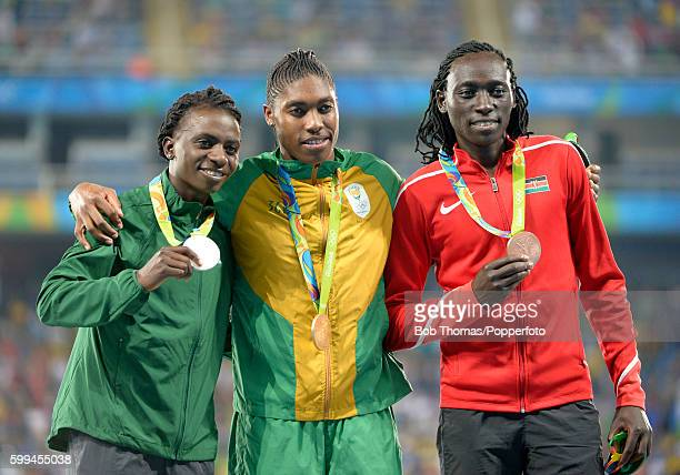 R Silver medalist Francine Niyonsaba of Burundi gold medalist Caster Semenya of South Africa and bronze medalist Margaret Nyairera Wambui of Kenya on...
