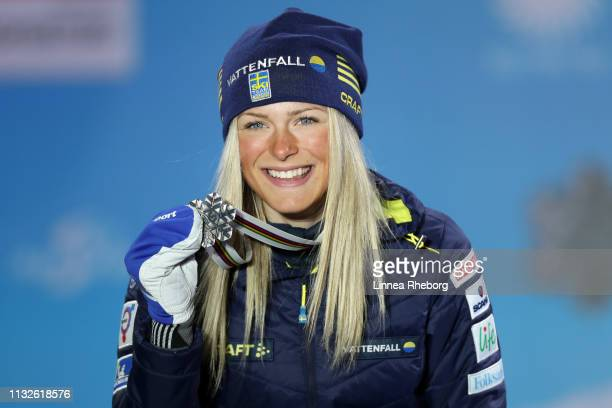 Silver medalist Frida Karlsson of Sweden celebrates with her medal during the medal ceremony for CrossCountry Women's 10km at the Medal Plaza on...