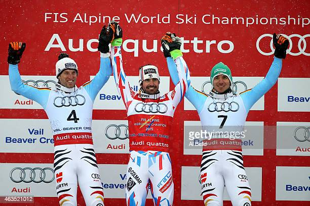 Silver medalist Fritz Dopfer of Germany gold medalist JeanBaptiste Grange of France and bronze medalist Felix Neureuther of Germany celebrate on the...