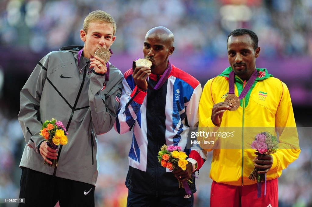 Silver medalist Galen Rupp of the United States, gold medalist Mohamed Farah of Great Britain and bronze medalist Tariku Bekele of Ethiopia pose on the podium for Men's 10,000m on Day 9 of the London 2012 Olympic Games at the Olympic Stadium on August 5, 2012 in London, England.