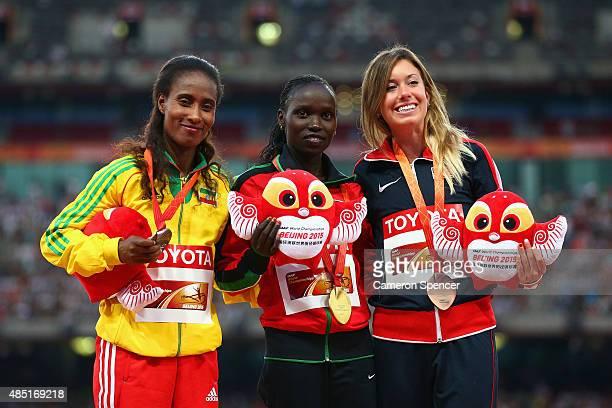 Silver medalist Gelete Burka of Ethiopia, gold medalist Vivian Jepkemoi Cheruiyot of Kenya and bronze medalist Emily Infeld of the United States pose...