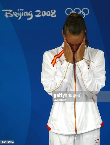 Silver medalist Gemma Mengual of Spain shows her emotions on the podium during the medal ceremony for the Synchronised Swimming Duet Free Routine...
