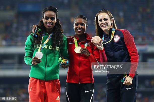 Silver medalist Genzebe Dibaba of Ethiopia gold medalist Faith Chepngetich Kipyegon of Kenya and bronze medalist Jennifer Simpson of the United...