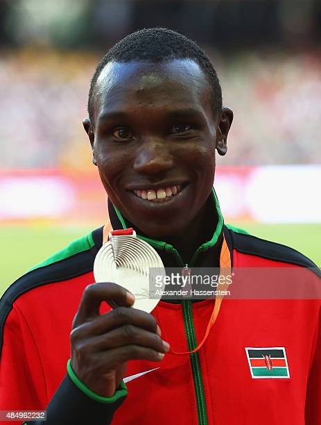 Silver medalist Geoffrey Kipsang Kamworor of Kenya poses on the podium during the medal ceremony for the Men's 10000 metres during day two of the...