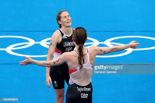 Silver medalist Georgia Taylor-Brown goes to hug Jessica Learmonth, both of Team Great Britain, during the Women's Individual Triathlon on day four...