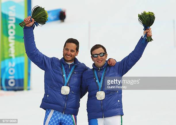 Silver medalist Gianmaria Dal Maistro of Italy and guide Tommaso Balasso celebrate at the medal ceremony for the Men's Visually Impaired Super...