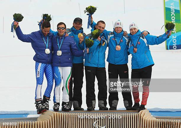 Silver medalist Gianmaria Dal Maistro of Italy and guide Tommaso Balasso gold medalist Jakub Krako of Slovakia and guide Juraj Medera and bronze...
