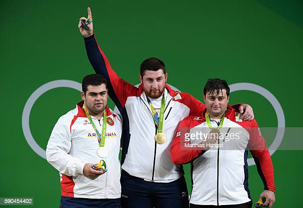 Silver medalist Gor Minasyan of Armenia gold medalist Lasha Talakhadze of Georgia and bronze medalist Irakli Turmanidze of Georgia stand on the...