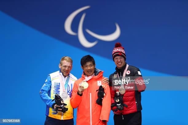 Silver medalist Grygorii Vovchynskyi of Ukraine gold medalist Yoshihiro Nitta of Japan and bronze medalist Mark Arendz of Canada celebrate during the...