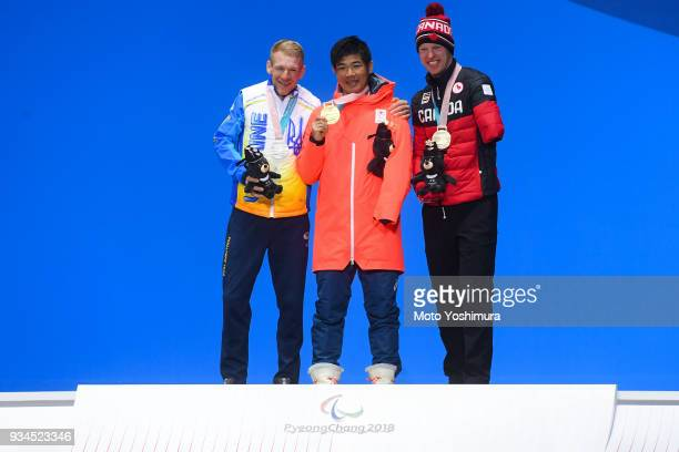 Silver medalist Grygorii Vovchynskyi of Ukraine gold medalist Yoshihiro Nitta of Japan and bronze medalist Mark Arendz of Canada celebrate during the...