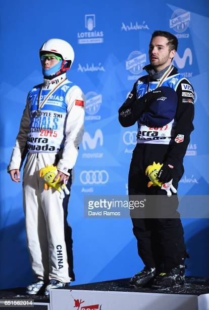 Silver medalist Guangpu Qi of China and gold medalist Jonathon Lillis of the United States stand on the podium during the medal ceremony for the...