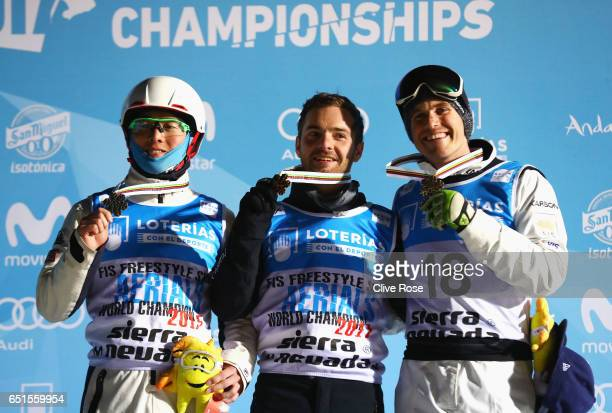 Silver medalist Guangpu Qi of China gold medalist Jonathon Lillis of the United States and bronze medalist David Morris of Australia celebrate during...