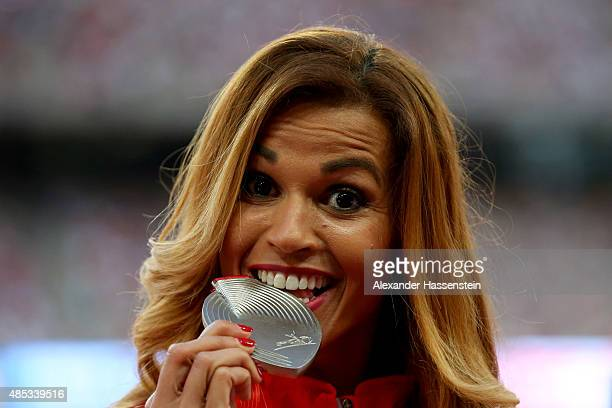 Silver medalist Habiba Ghribi of Tunisia poses on the podium during the medal ceremony for the Women's 3000 metres steeplechase final during day six...