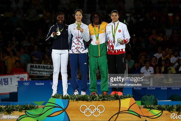 Silver medalist Haby Niare of France gold medalist Hyeri Oh of South Korea and bronze medalists Ruth Gbagbi of Cote d'Ivoire and Nur Tatar of Turkey...