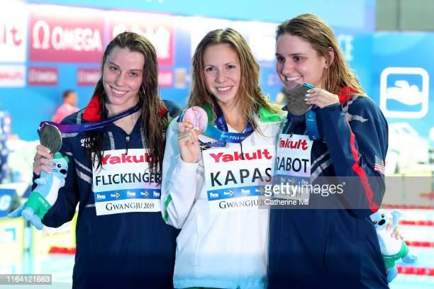 Silver medalist Hali Flickinger of the United States gold medalist Boglarka Kapas of Hungary and bronze medalist Katie Drabot of the United States...