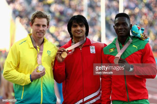 Silver medalist Hamish Peacock of Australia gold medalist Neeraj Chopra of India and bronze medalist Anderson Peters of Grenada pose during the medal...