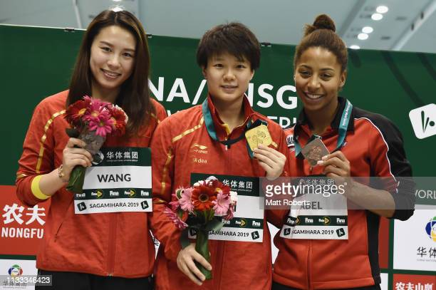 Silver medalist Han Wang of China gold medalist Tingmao Shi of China and bronze medalist Jennifer Abel of Canada pose during the medal presentation...