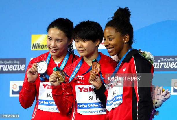 Silver medalist Han Wang of China gold medalist Tingmao Shi of China and bronze medalist Jennifer Abel of Canada pose with the medals won during the...
