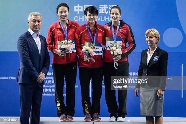 Silver medalist Han Wang of China gold medalist Tingmao Shi of China and bronze medalist Pamela Ware of Canada pose on the podium at the medal...