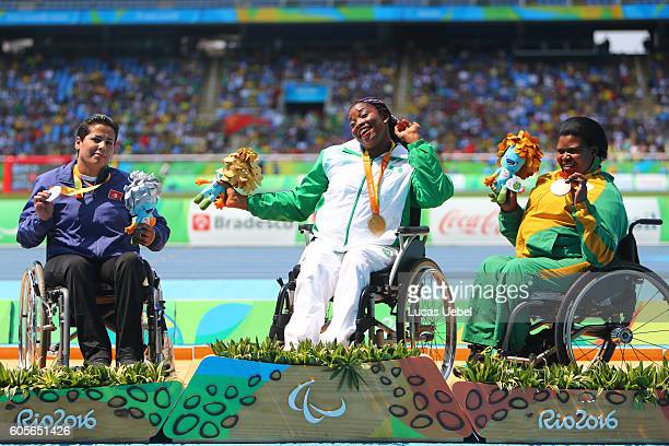 Silver medalist Hania Aidi of Tunisia, gold medalist Flora Ugwunwa of Nigeria and bronze medalist Ntombizanele Situ of South Africa pose on the...