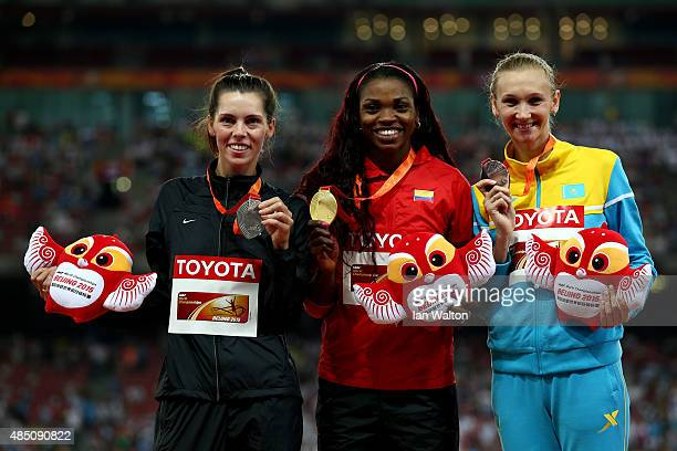 Silver medalist Hanna KnyazyevaMinenko of Israel gold medalist Caterine Ibarguen of Colombia and bronze medalist Olga Rypakova of Kazakhstan pose on...