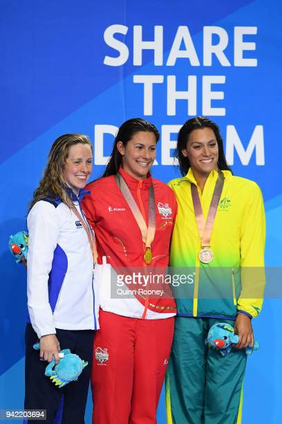 Silver medalist Hannah Miley of Scotland, gold medalist Aimee Willmott of England and bronze medalist Blair Evans of Australia pose during the medal...