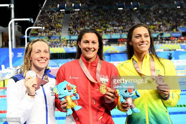 Silver medalist Hannah Miley of Scotland gold medalist Aimee Willmott of England and bronze medalist Blair Evans of Australia pose during the medal...