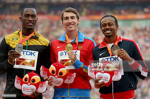 Silver medalist Hansle Parchment of Jamaica gold medalist Sergey Shubenkov of Russia and bronze medalist Aries Merritt of the United States pose on...