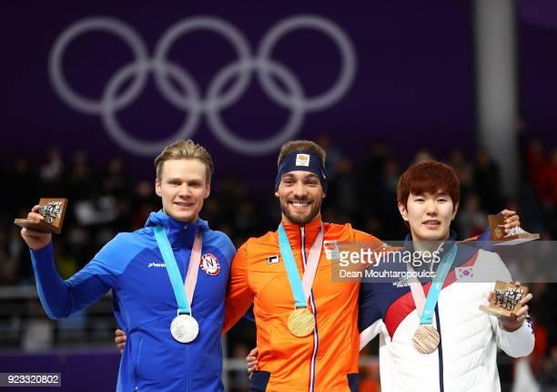 Silver medalist Havard Lorentzen of Norway gold medalist Kjeld Nuis of the Netherlands and bronze medalist TaeYun Kim of Korea celebrate during the...
