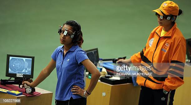 Silver medalist Heena Sidhu of India and gold medalist Ng Pei Chin Bibiana of Malaysia compete in the women's singles 10m air pistol event of the XIX...