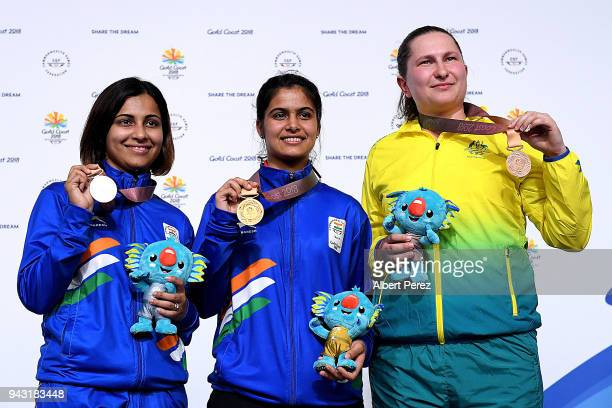Silver medalist Heena Sidhu of India gold medalist Manu Bhaker of India and bronze medalist Elena Galiabovitch of Australia pose during Women's 10m...