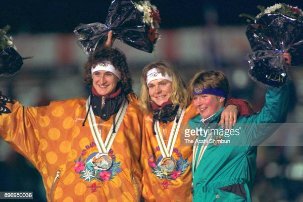 Silver medalist Heike Warnicke gold medalist Gunda NiemannStirnemann and bronze medalist Claudia Pechstein of Germany pose on the podium at the medal...