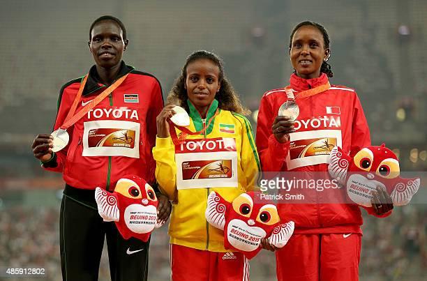 Silver medalist Helah Kiprop of Kenya gold medalist Mare Dibaba of Ethiopia and bronze medalist Eunice Jepkirui Kirwa of Bahrain pose on the podium...