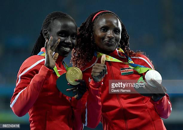 Silver medalist, Hellen Onsando Obiri of Kenya, and gold medalist, Vivian Jepkemoi Cheruiyot of Kenya, pose on the podium during the medal ceremony...