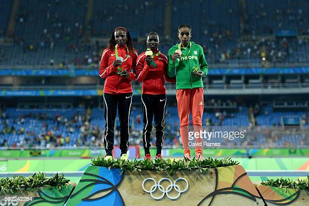 Silver medalist, Hellen Onsando Obiri of Kenya, gold medalist, Vivian Jepkemoi Cheruiyot of Kenya, and bronze medalist Almaz Ayana of Ethiopia, pose...