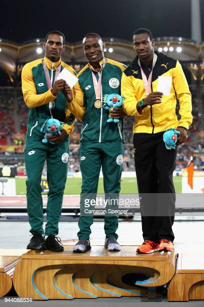Silver medalist Henricho Bruintjies of South Africa, gold medalist Akani Simbine of South Africa and bronze medalist Yohan Blake of Jamaica pose...