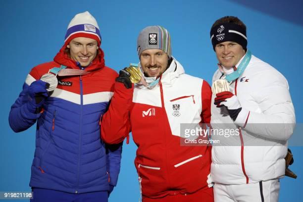 Silver medalist Henrik Kristoffersen of Norway gold medalist Marcel Hirscher of Austria and bronze medalist Alexis Pinturault of France celebrate...